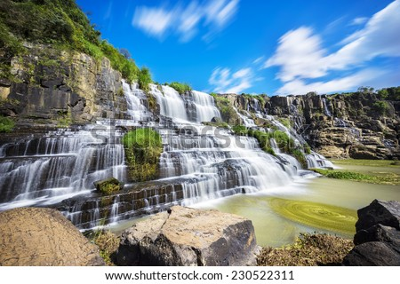 Beautiful Pongour waterfall in Da Lat, Lam Dong province, Vietnam. Da lat is one of the best tourism city in Vietnam. Dalat city is Vietnam's largest vegetable and flowers growing areas. - stock photo
