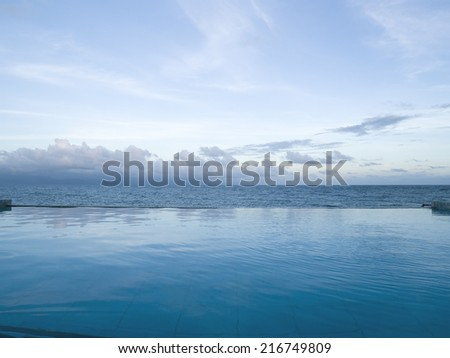Beautiful pool view against sea - stock photo