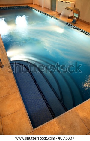 Beautiful pool with current water in modern hotel - stock photo