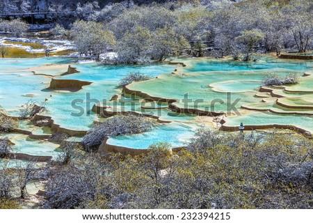 Beautiful pools in Huanglong National Park near Jiuzhaijou  after snowstorm - SiChuan, China - stock photo