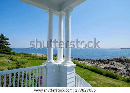 beautiful porch and columns of the Marshall Point Lighthouse keepers quarters - stock photo