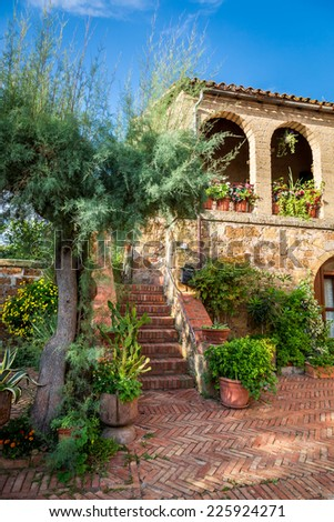 Beautiful porch in the ancient town in Tuscany - stock photo