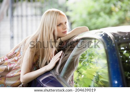 beautiful portrait  blonde woman in car background - stock photo