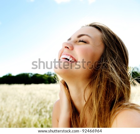 beautiful portrait of a carefree friendly approachable girl with a stunning smile and cute looks - stock photo
