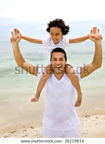 Beautiful portrait of a father and son at the beach - stock photo