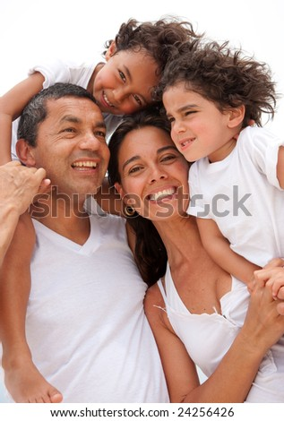 Beautiful portrait of a happy family outdoors during vacations - stock photo