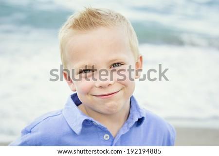 Beautiful Portrait of a Happy little boy - stock photo