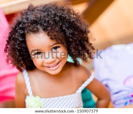 Beautiful portrait of a happy little girl smiling  - stock photo