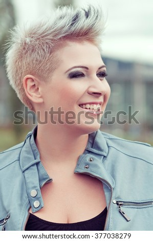 Beautiful portrait of a happy young woman - stock photo
