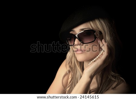 Beautiful portrait of a sexy woman on a black background - stock photo