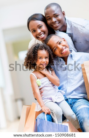 Beautiful portrait of an African American shopping family  - stock photo