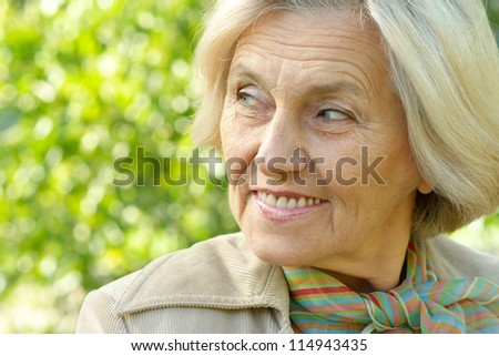 beautiful portrait of an old woman on the autumn