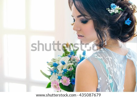 Beautiful portrait of bride in Wedding makeup and hair, jewelry, and bride model beauty girl face, beauty, bride, gorgeous, isolated rooms, Studio, series. Fashionable color of serenity. - stock photo