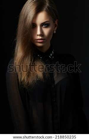 Beautiful portrait of girl on black background.