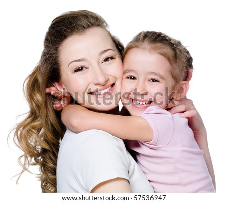 Beautiful portrait of happy cheerful mother with little daughter in embrace - stock photo