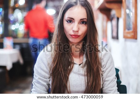 Beautiful portrait of kind girl in a cafe