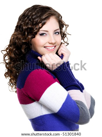 Beautiful portrait of nice pretty happy woman in multicolored  winter sweater - stock photo
