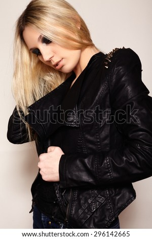 Beautiful portrait of rock woman model in leather jacket with dark evening make-up. Perfect street fashion. Personal accessories, clothes - stock photo