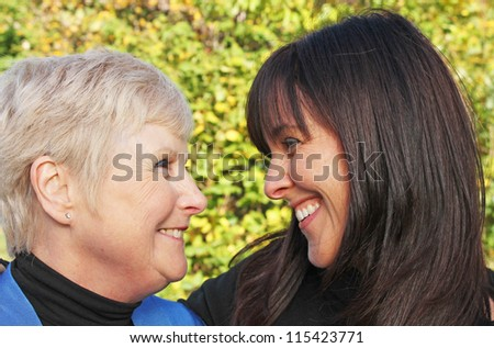 Beautiful portrait of senior mother and daughter laughing