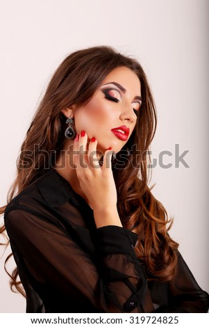 Beautiful portrait of sensual european young woman model with glamour red lips make-up, eye arrow makeup, purity skin.   - stock photo