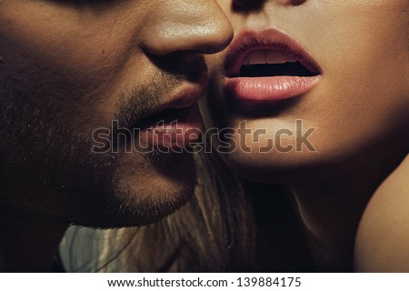 Beautiful portrait of young man lips - stock photo