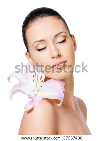 Beautiful portrait of young sensual woman with flower on her shoulder