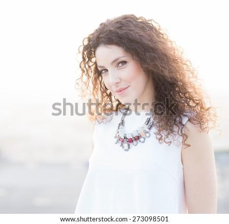 Beautiful Portuguese Woman Portrait at Sunset - stock photo