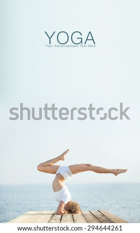Beautiful positiveblond girl practicing yoga at seashore and meditating  - stock photo