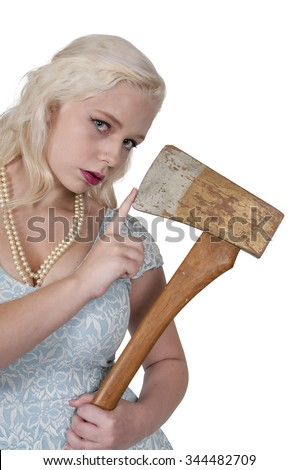 Beautiful possessed woman in a trance holding an axe - stock photo