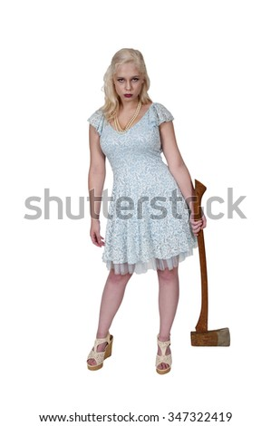 Beautiful possessed woman in a trance holding an axe