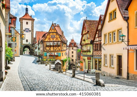Beautiful postcard view of the famous historic town of Rothenburg ob der Tauber on a sunny day with blue sky and clouds in summer, Franconia, Bavaria, Germany - stock photo