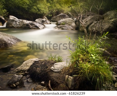 Beautiful pound in a river. ND Filter used to increase the time of shooting and create a magical atmosphere - stock photo