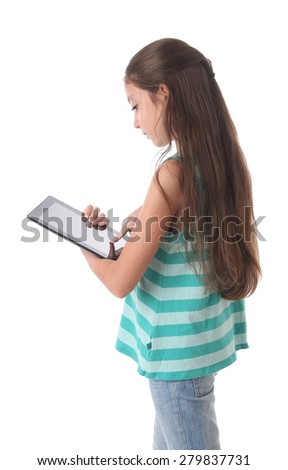 Beautiful pre-teen girl using a tablet computer. Clipping path for the screen - stock photo