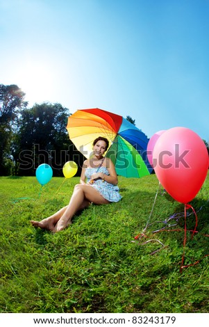 Beautiful pregnant belly in an outdoor setting - stock photo