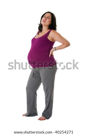 Beautiful pregnant Caucasian brunette woman holding her back with an uncomfortable expression. Pregnancy contraction back pains, isolated. - stock photo
