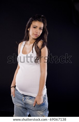 Beautiful pregnant urban woman - stock photo