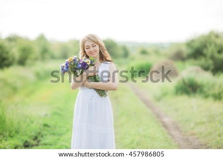 Beautiful pregnant woman - stock photo