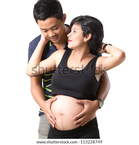 Beautiful pregnant woman and her husband, Isolated over white - stock photo