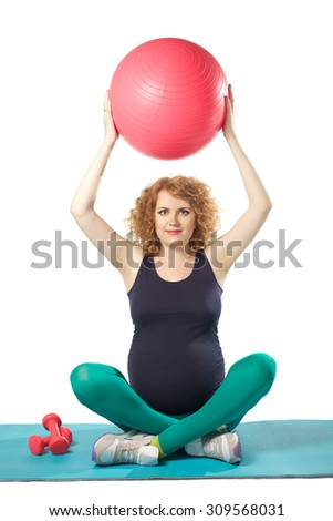 beautiful pregnant woman doing exercise with ball and dumbbells  on isolated white background