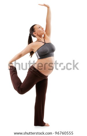 Beautiful pregnant woman doing exercises - stock photo