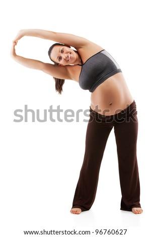 Beautiful pregnant woman doing exercises - stock photo