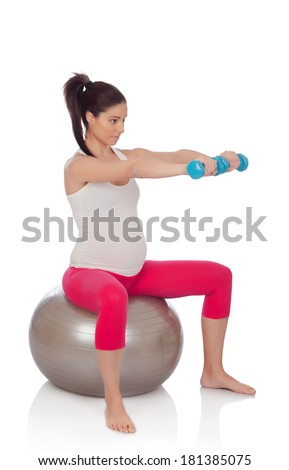 Beautiful pregnant woman doing sport isolated on white background - stock photo