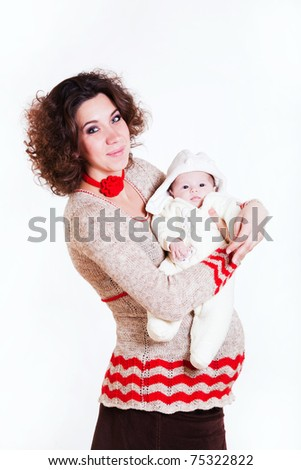 beautiful pregnant woman in a sweater with baby isolated on white background