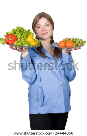 beautiful pregnant woman in blue with fruit and vegetables on white - stock photo