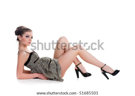 Beautiful pregnant woman in short dress isolated on white - stock photo