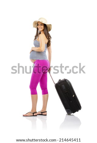 Beautiful pregnant woman in summer clothes and straw hat ready to travel, isolated on white - stock photo