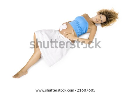 Beautiful pregnant woman lying down on the floor and isolated on white background