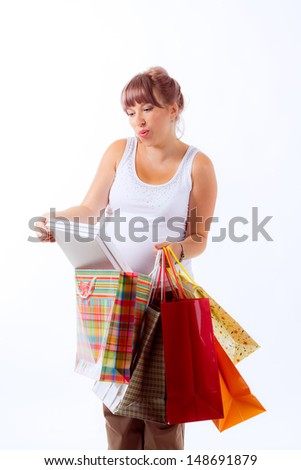 beautiful pregnant woman on a white background with shopping bags