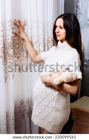 Beautiful pregnant woman. pregnant woman caressing her belly - stock photo