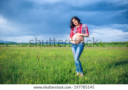 Beautiful pregnant woman relaxing outside